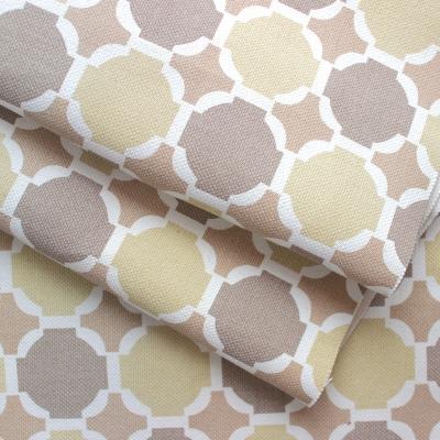 Tissu en coton à pois beige, blanc et brun sur fond beige