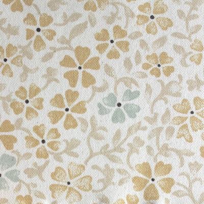 Beige katoen stof met groene en gele bloemen