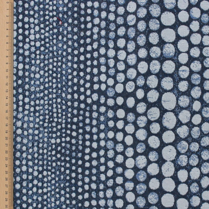 Printed fabric with white dots on a blue background