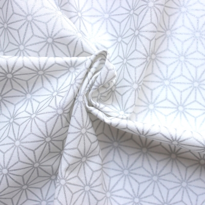 Cotton fabric with white and black geometric design on pink background