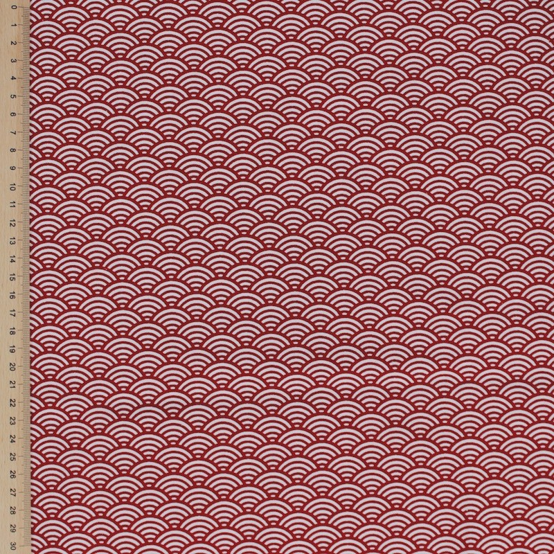 Cotton fabric with white and red geometric design