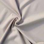 Tissu en polyester aspect peau de pêche uni gris