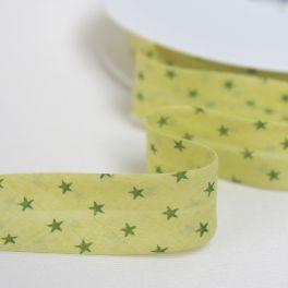 Biais à étoiles vertes sur fond jaune vert