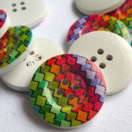 Wooden button printed with colored zigzag pattern