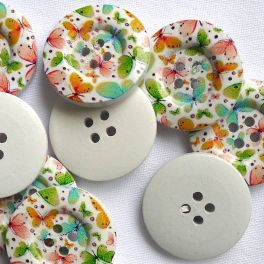 Wooden button printed with colored butterflies