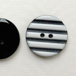 Bouton en résine noir à lignes blanches