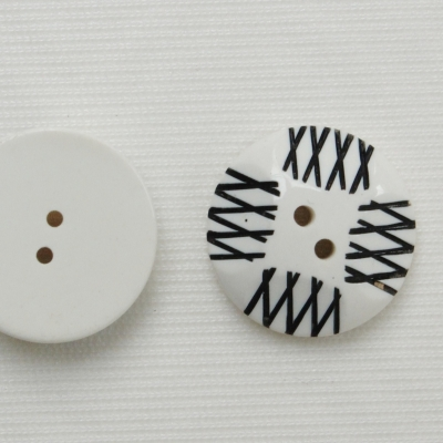 Black and white polyester button