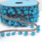 Lichtbruin bandje met blauwe pompons