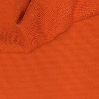 Verduisterende stof met linnen aspect oranje