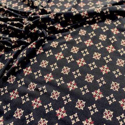 Tissu jersey strech avec motifs noir, bordeau et crème