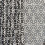 Cotton and polyester fabric with black geometric design