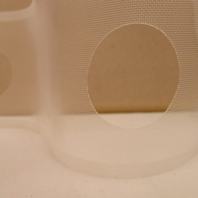 Perforated transparent strap in polyester