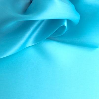 Organza satin de soie turquoise