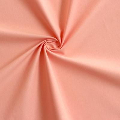 Tissu cretonne uni rose pêche