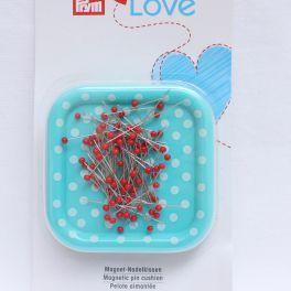 Epingles tête de verre sur boite aimant