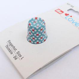 Blue thimble with red and white dots