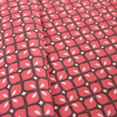 Tissu d'ameublement à motif mosaique framboise