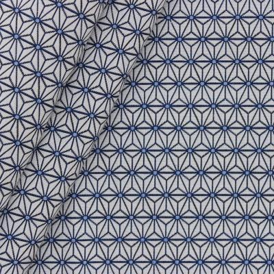 Tissu jacquard à petit motif origami bleu fond grège