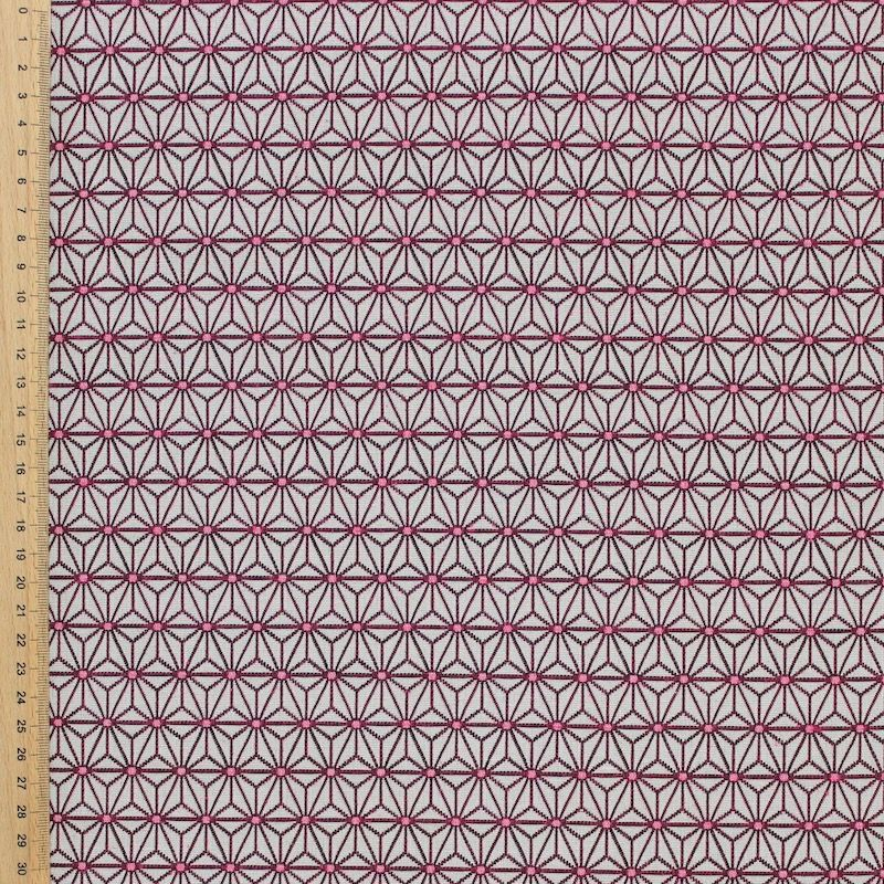 Furniture fabric printed with small fuschia origami patterns on a greige background
