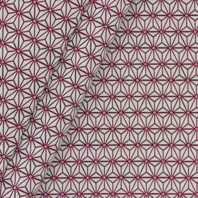 Meubelstof met kleine fuschia origami motiefjes op een greige achtergrond