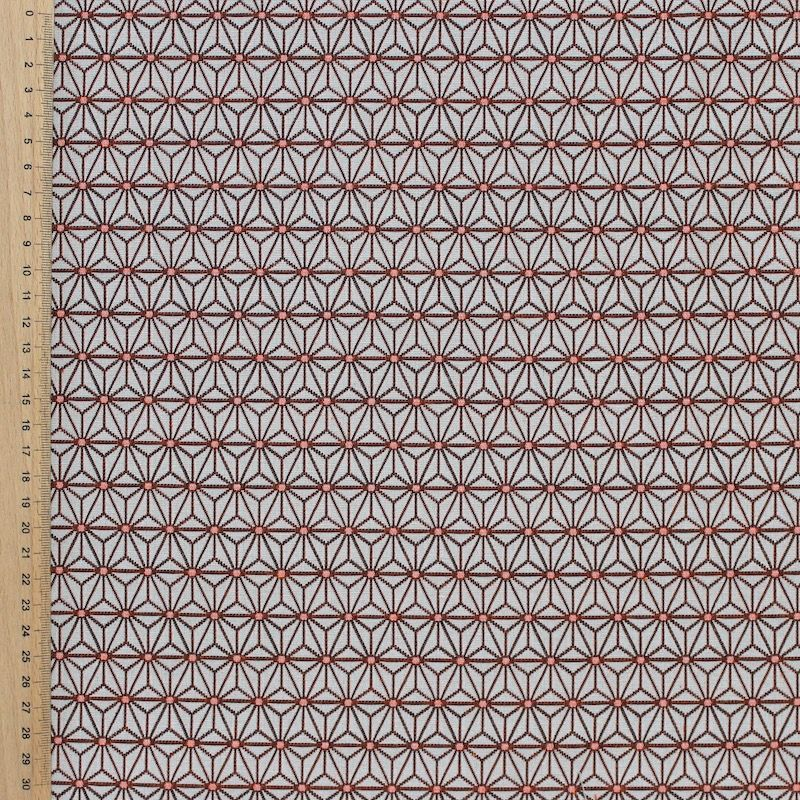Furniture fabric printed with small orangeorigami patterns on a greige background
