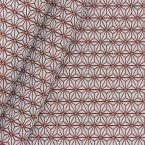 Meubelstof met kleine oranje origami motiefjes op een greige achtergrond