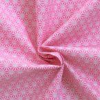 Tissu en coton à motifs origami blanc sur fond rose pastel