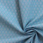 Cotton fabric with white geometric design on a pale turquoise background