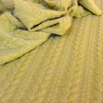 Quilted jersey fabric twisted pistachio green with fluffy fleece back