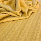 Tissu jersey matelassé à motif torsade jaune moutarde