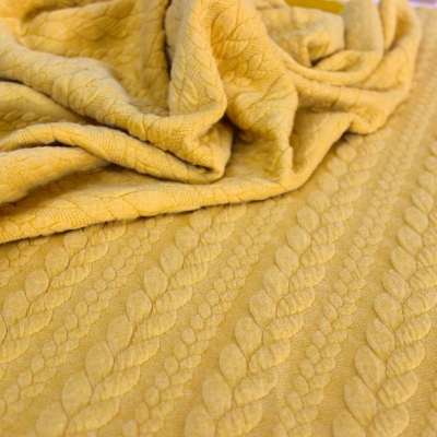 Quilted jersey fabric with musterd yellow twist and fluffy fleece back