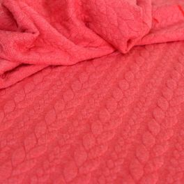 Quilted jersey fabric with coral red twist and fluffy fleece back