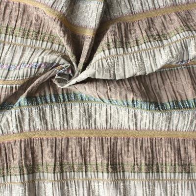 Tissu en coton, viscose et polyamide à fleurs et lignes beige