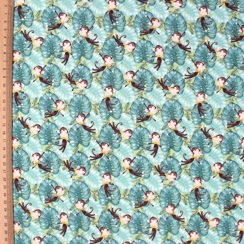 Cotton Poplin printed with flowers on a bottle green background