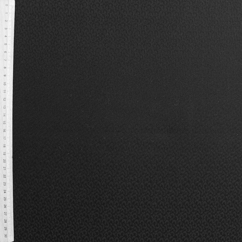 Tissu imprimé léopard noir ton sur ton