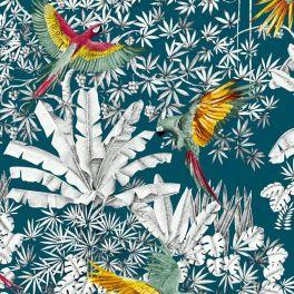Tissu imprimé de perroquets vert et jaune sur fond bleu lagon