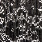 zwarte jersey bedekt met zwarte, matte pailletten.
