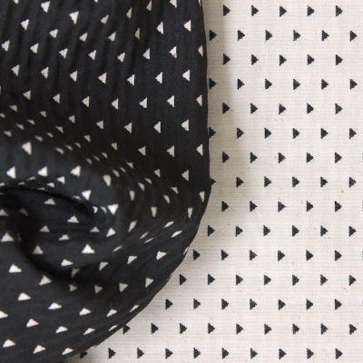 Black, grey and beige knitwear fabric with geometric pattern