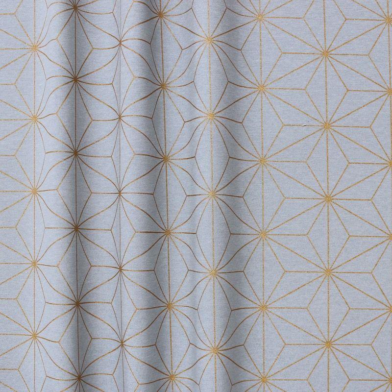 Tissu d'ameublement à motif géométrique doré sur fond gris