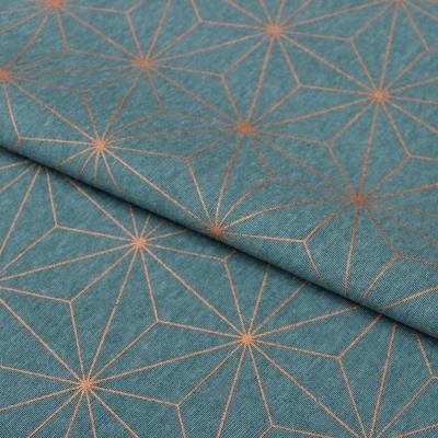 Tissu d'ameublement à motif géométrique cuivré sur fond bleu canard