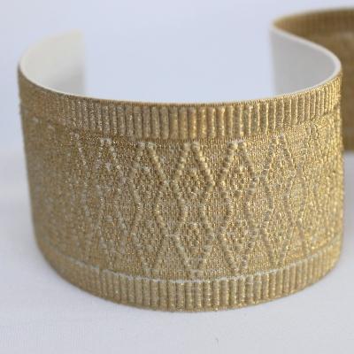 Elastique plat 5cm à motif en relief doré