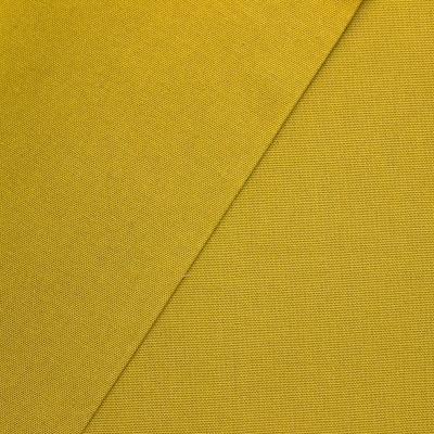 Tissu en coton uni vert pistache
