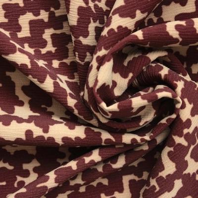 Tissu en crêpe motif vintage ocre et beige