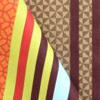 Tissu d'ameublement rayé multi motifs taupe et orange