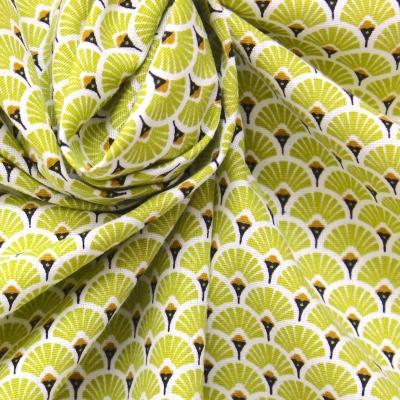 Tissu en coton à motif d'éventails vert citronelle