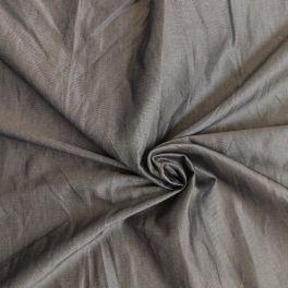 Tissu en coton fond beige effet métal noir