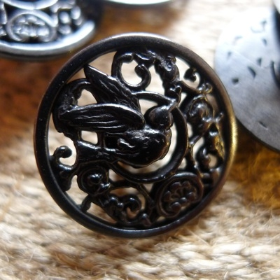 Bouton vintage en aspect métal