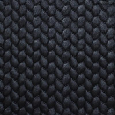 Fausse fourrure à motif embossé noir