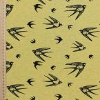 Tissu jersey chiné motif hirondelles jaune