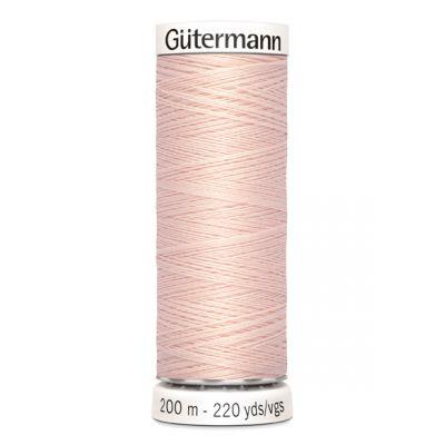 Fil à coudre rose Gütermann 658